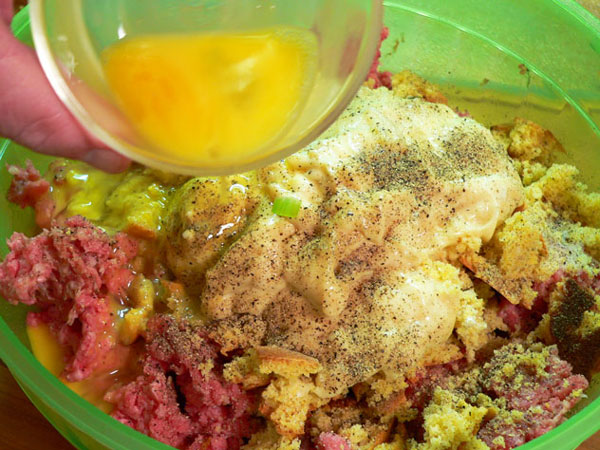 Sausage-Beef-Meatloaf, add the eggs to the mixture.
