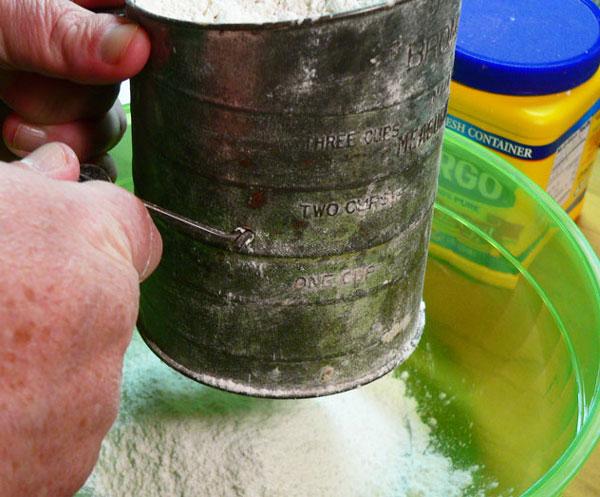 True Pound Cake, sift the flour.