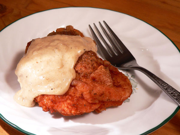 Fried Chicken with Gravy, serve warm and enjoy.