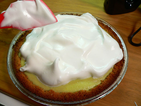 Key Lime Pie, spread the meringue on top of the hot pie.