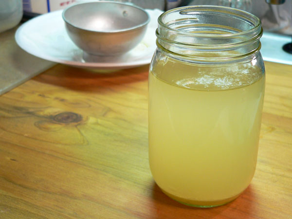 How To Render Leaf Lard, hot oil that has just been strained.