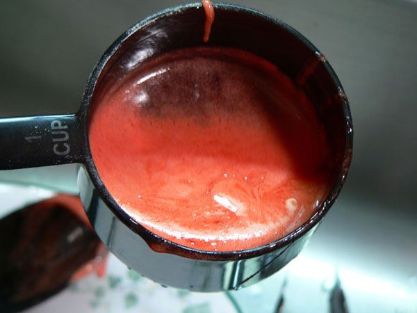 Strawberry Syrup, skim off any foam.