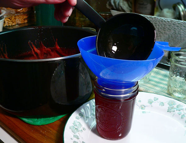Strawberry Syrup, ladle the syrup into the jars.