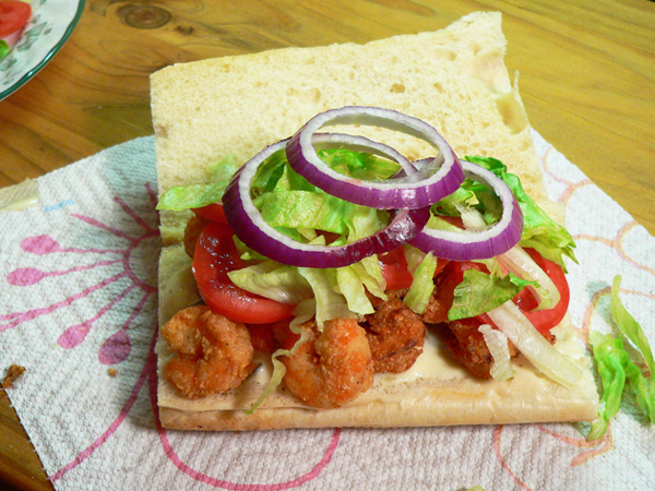 Shrimp Po' Boy, add onions if desired.