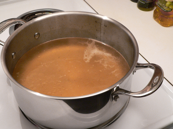 Chicken and Rice, bring stock to a boil.