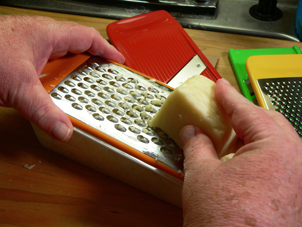 Easy Pizza Dough, grating the cheese.