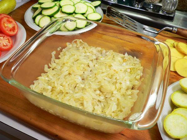 Vegetable Casserole, add onions to casserole dish.