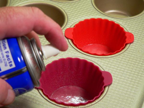 Chocolate Sour Cream Cupcakes, spray the cups.
