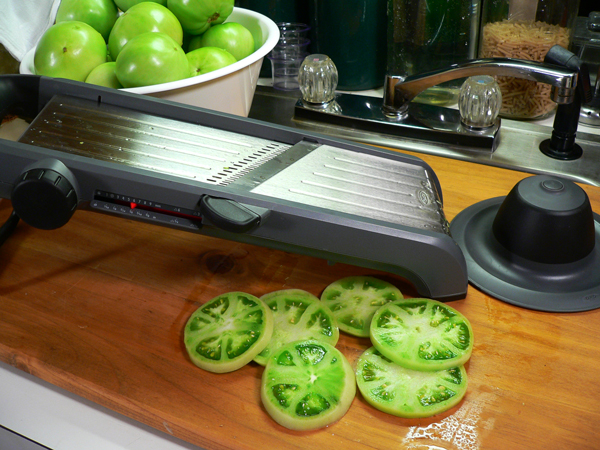 Pickled Green Tomatoes, slice the tomatoes.