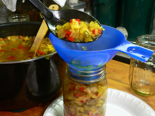 Chow Chow Relish, ladle mixture into the jars.