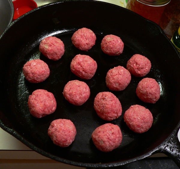 Meatball Appetizers, place meatball in a skillet.
