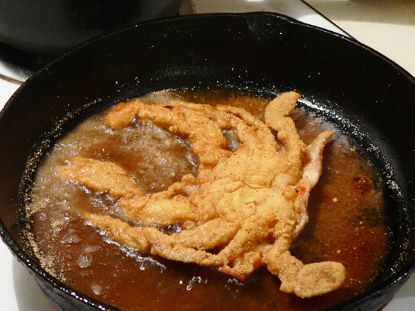 Soft Shell Crab, turn and fry to a golden brown.