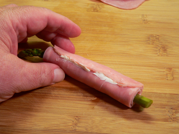 Ham and Asparagus Rollups, seal with cream cheese.