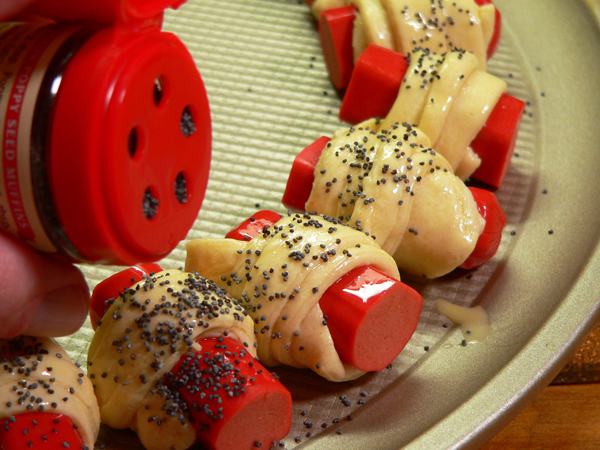 pigs-in-a-blanket, add the poppy seeds.