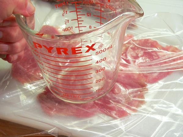 Pork Tenderloin Biscuits, pound the slice flat.