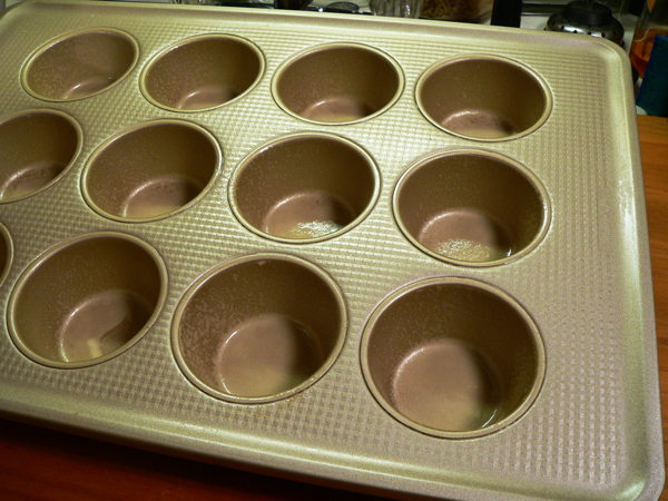 Pumpkin Spice Muffins, spray your muffin pan.
