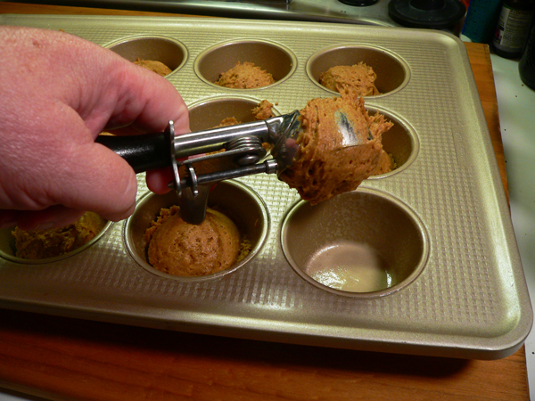 Pumpkin Spice Muffins, scoop the batter.
