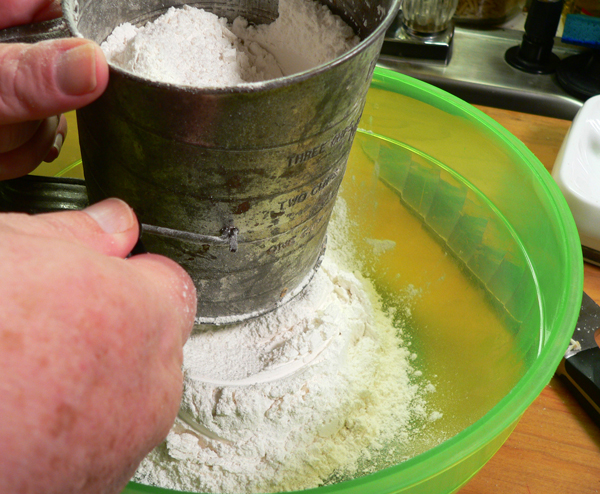 Orange Slice Cake, sift the flour.