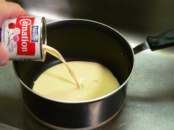 Pineapple Cake, add the milk.