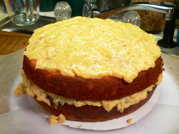 Pineapple Cake, frost the top.