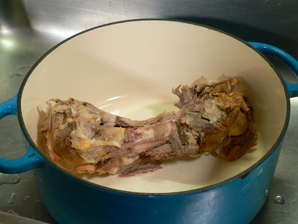 Ham Bone Soup, place the ham bone in a large dutch oven.