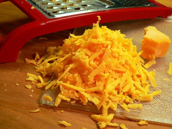 Broccoli Casserole, grate the cheese.