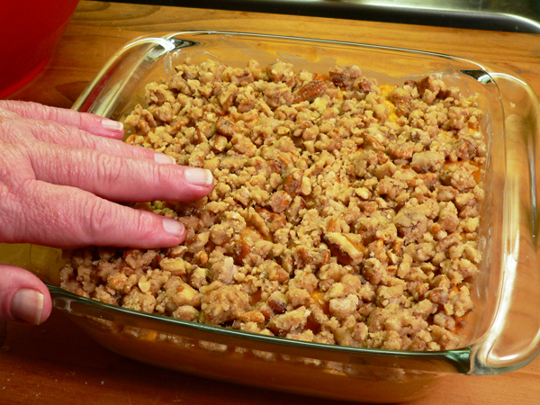 Sweet Potato Casserole, spread the topping over the sweet potato mixture.