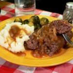 Hamburger Steak with Onions and Gravy recipe, as seen on Taste of Southern.