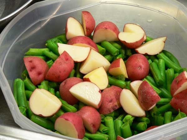 Green Beans and Potatoes, cut the potatoes.