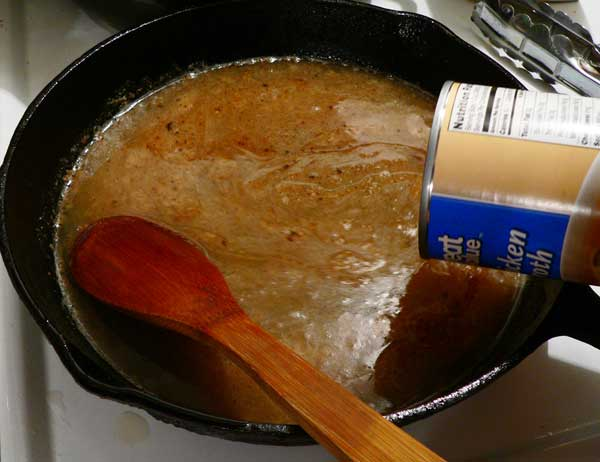 Chicken Gizzards with Gravy, slowly add the broth.