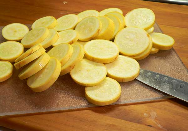 Squash and Onions, slice the squash.