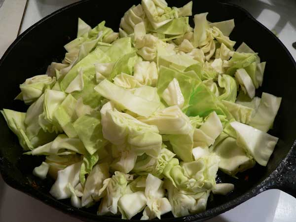 Fried Cabbage, add the cabbage.