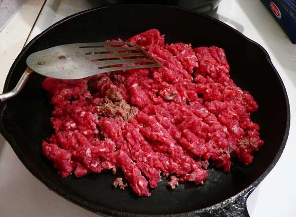 Ground Beef with Mushroom Gravy, break it up as it begins to brown.