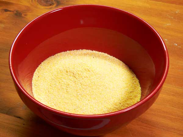 Hot Water Cornbread, place cornmeal in small mixing bowl.