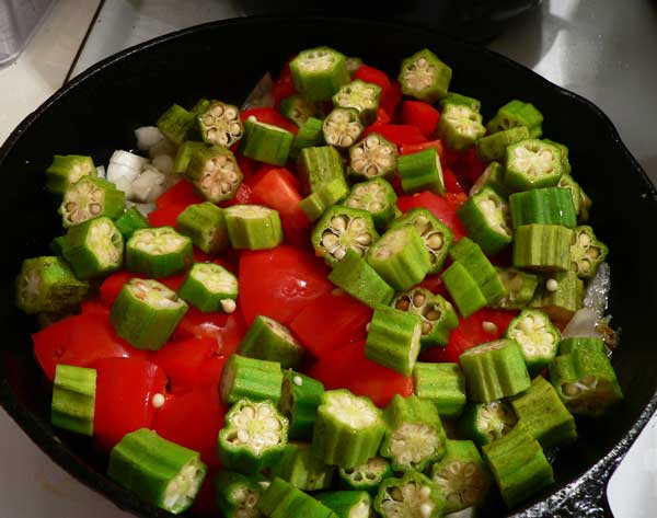 Okra and Tomatoes, add the okra to the skillet.