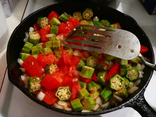 Okra and Tomatoes, simmer and stir often.