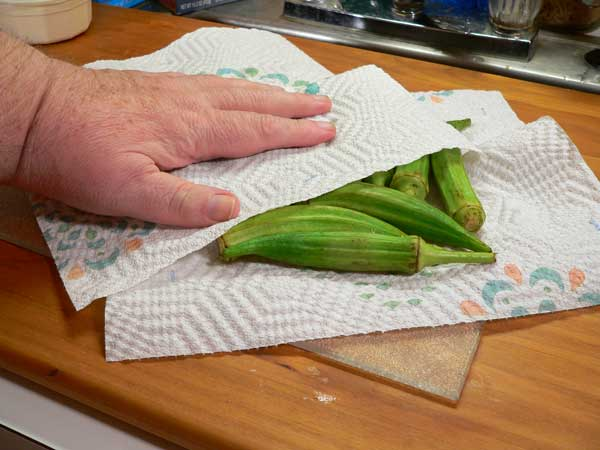 Pan Fried Okra, pat the okra dry with some paper towels.