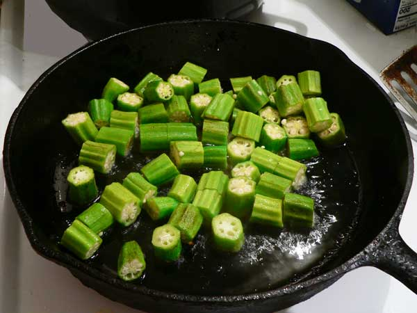 Pan Fried Okra, add the cut okra.