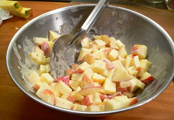 Waldorf Salad, toss the apples in the dressing.