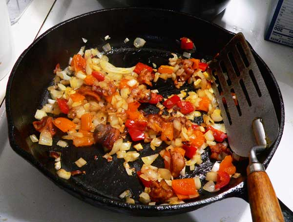 Corn Maque Choux, cook until the onions are tender.