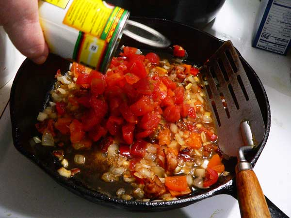 Corn Maque Choux, add the can of tomatoes.