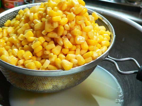 Corn Maque Choux, drain 3 cans of corn.