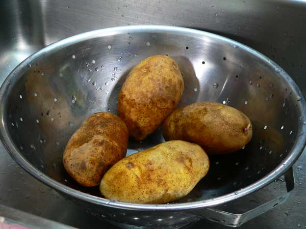 Southern Fried Potatoes, wash the potatoes.