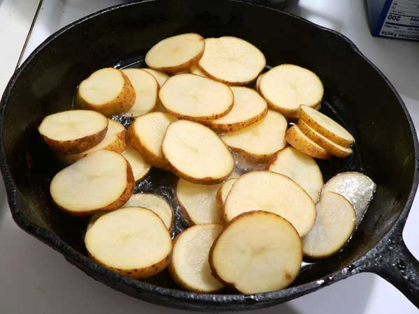 Southern Fried Potatoes, add the potatoes to the skillet.