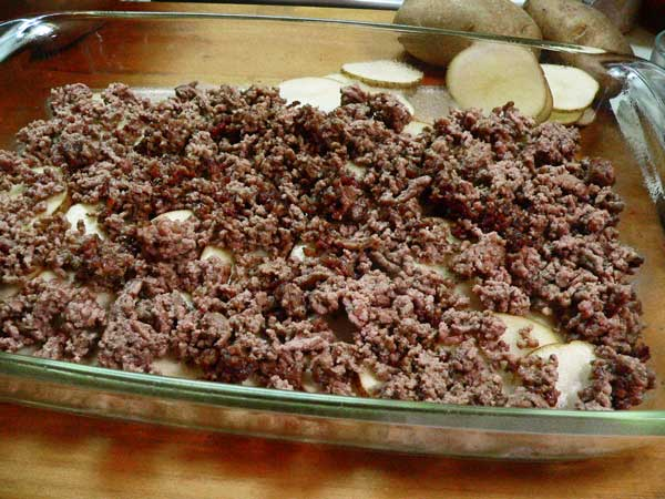 Hamburger Casserole, add half of the ground beef.