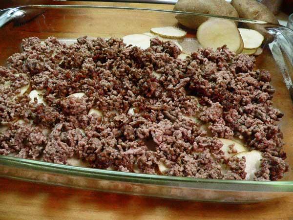 Hamburger Casserole, add half of the ground beef.