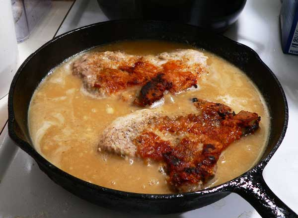 Pork Chops with Gravy, return the chops to the pan.