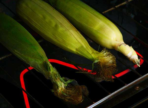 Roast Corn, place corn on middle rack in the oven.