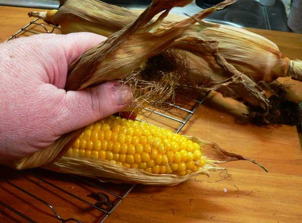 Roast Corn, pull back husks and silks.