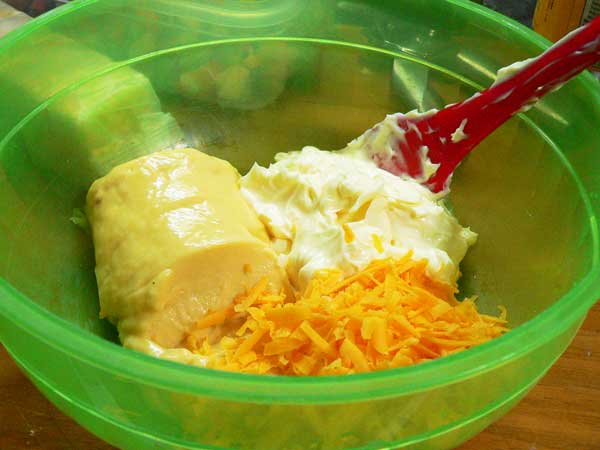 Veg-All Casserole, add the soup, mayonnaise, and the cheese.
